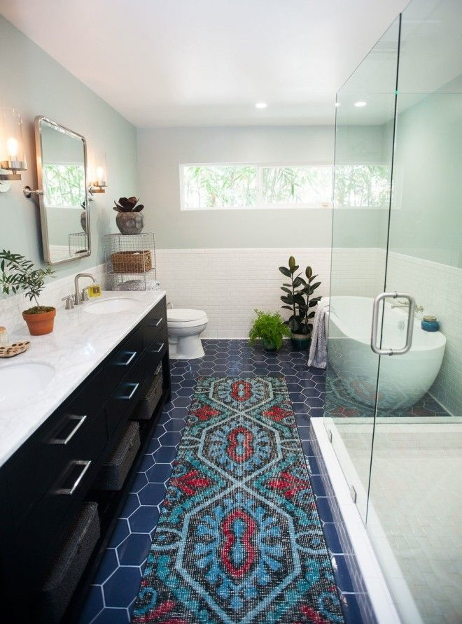 Master bathroom makeover with beautiful blue hexagon tile, glass shower, and statement bath tub with @jenpinkston