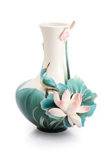 """Through the interactions between the """"flowers"""" and the """"bird"""", this piece delivers the essence of Franz philosophy and offers consumers a new perspective to learn the meaning of perfection. The big leaves covering the body make the form not only three-dimensional but also multi-layered. The lotus blossoms along the body to the mouth of the vase and the leaves have a stable and dark green color with a cool feel."""