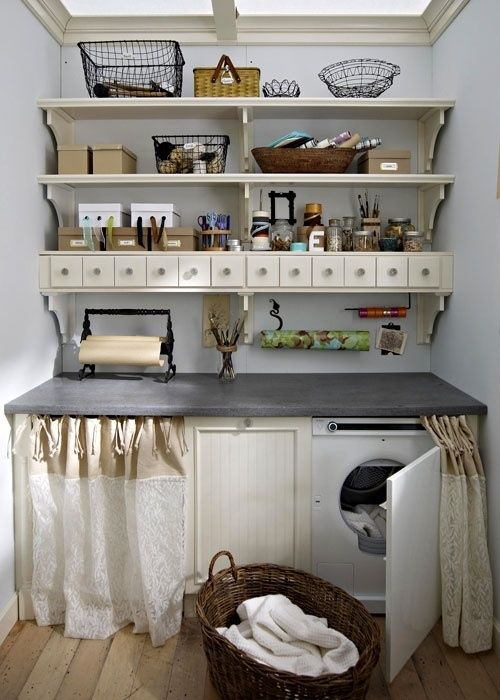 Use curtains to cover up the washer and dryer. Love the countertop and drawers above. Very cute