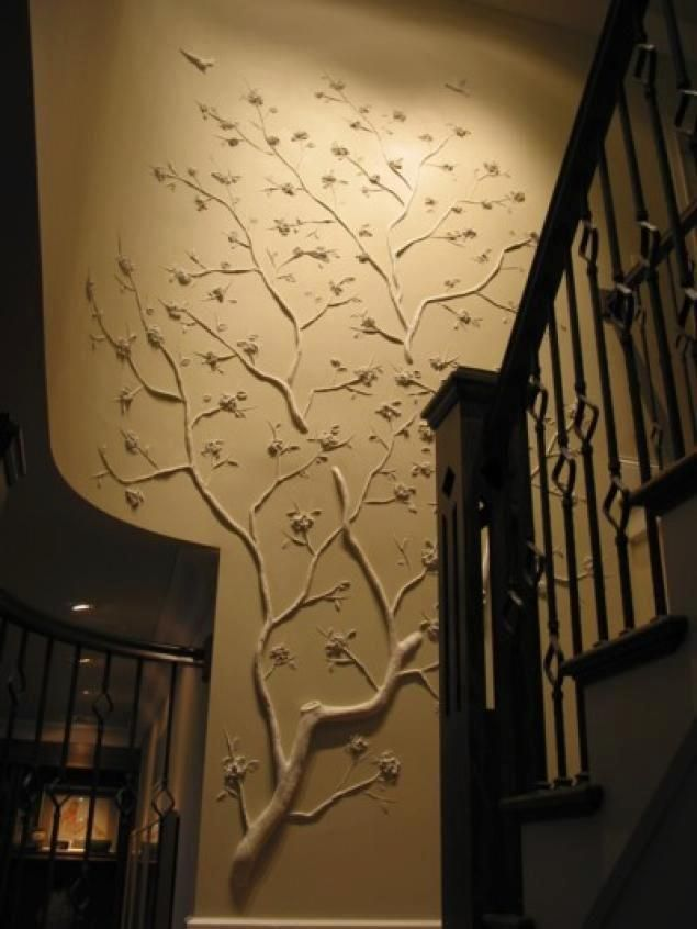 Creative wall design simply made from tree branches attached to the wall and painted