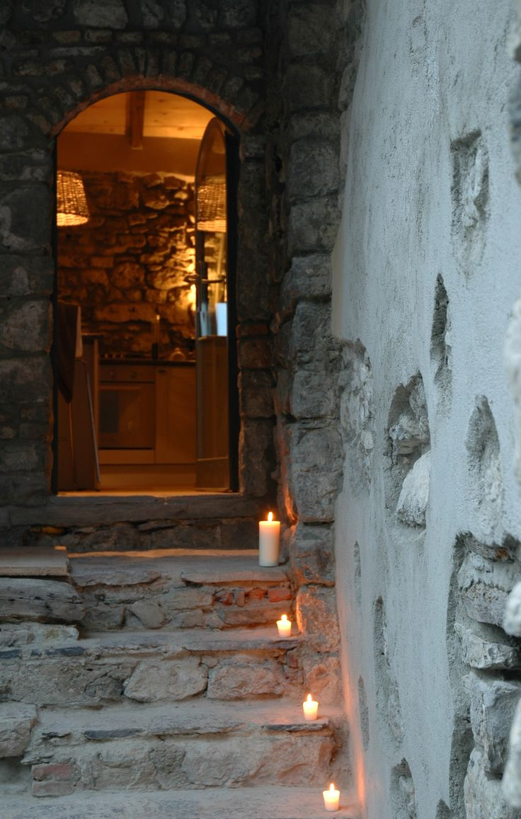 Candlelit stone steps up to the entrance to Ambra