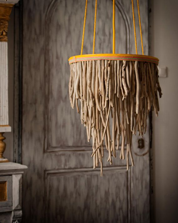 A chandelier crafted from driftwood makes a stunning focal point. #NauticalJuly