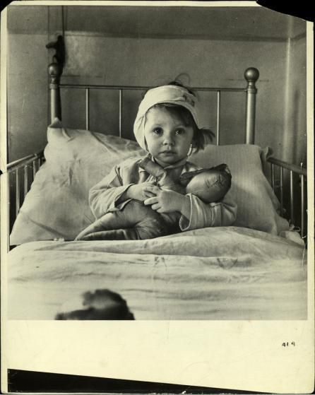 Cecil Beaton. Cover of Life magazine. Three-year-old Eileen Dunne, a victim of the London Blitz, in hospital, 1940.