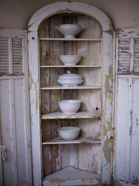 White ironstone platters, bowls, and pitchers with corner shelf and shutter doors from Vintage Ambiance