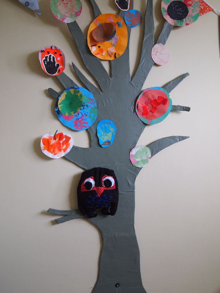 Large cardboard tree decorated with my son's artwork from nursery. Detachable owl for story telling.