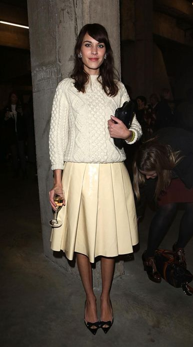 Alexa Chung: cable knit sweater, pleated leather midi skirt.