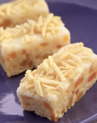 APRICOT SLICE 1 cup diced dried apricots 1 cup oats 1 cup coconut 1 cup self-raising flour 125g melted butter 1 tbs honey 1 beaten egg Method Combine all the ingredients together and spread the mixture on to a greased slice tray. Bake for about 25 minutes in a moderate oven - 180C. Optional: top with icing and sliced almonds.