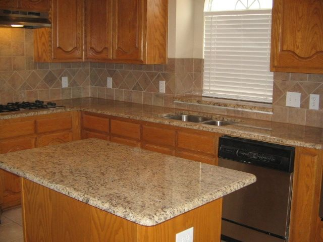 Giallo Ornamental Granite Countertops Marble Backsplash