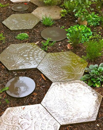 While the vertical gardens showcase Beck's innovative approach to the native Australian garden, the hardscape and pavers refer to his time spent admiring the minimalism and simplicity of Japanese garden design. Hexagonal concrete pavers imprinted with original organic forms are accompanied by plain round pavers.