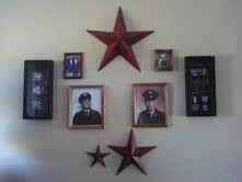 Military Entry Wall.  The shadow boxes hold my childrens High School ROTC bars and ribbons and the pictures are family members who served in all branches of the service.