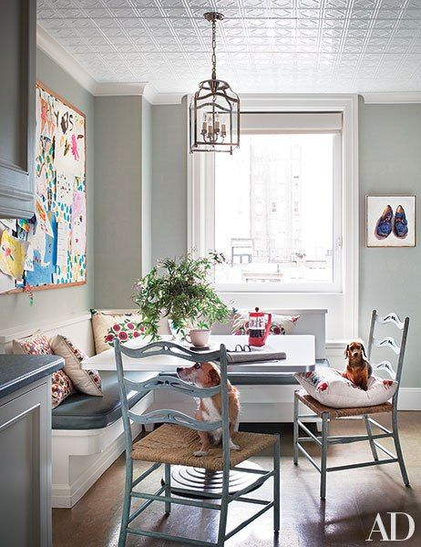 Mornings start early at the Michael S. Smith–designed New York City home of actress Alexandra Wentworth and television journalist George Stephanopoulos. In the breakfast area, the family's two dogs are seated on chairs by David Iatesta.