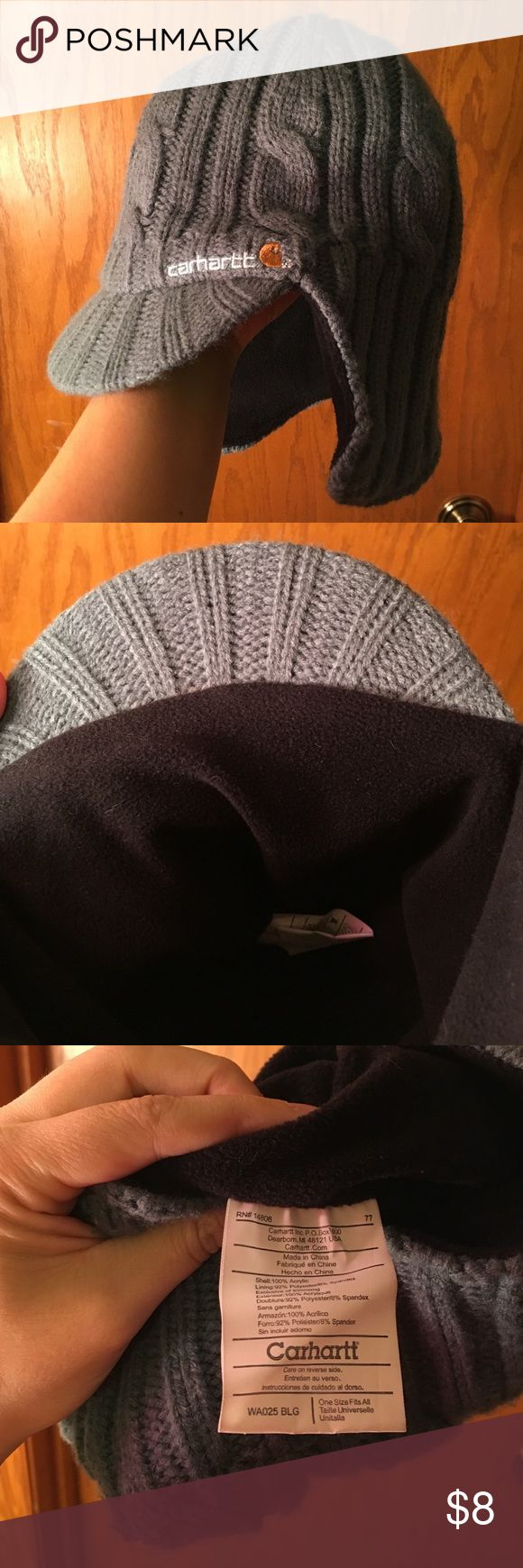 Carhartt winter hat Warm Carhartt women's cap.  Sweater like exterior, small bill on the front, fleece interior.  That wind won't touch your ears in this cap!  Built to famous Carhartt standards.  Worn once. Carhartt Accessories Hats
