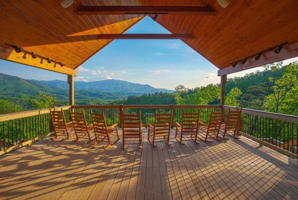"Gatlinburg Mansion. Tennessee vacation rentals. "" Gatlinburg $1460 per night Mansion""  is a 14 bedroom luxury cabin,  overlooking The Great Smoky Mountains Mount Leconte.  Awe- inspiring views &  memorable times await you!   Providing the ultimate in  vacation rental."
