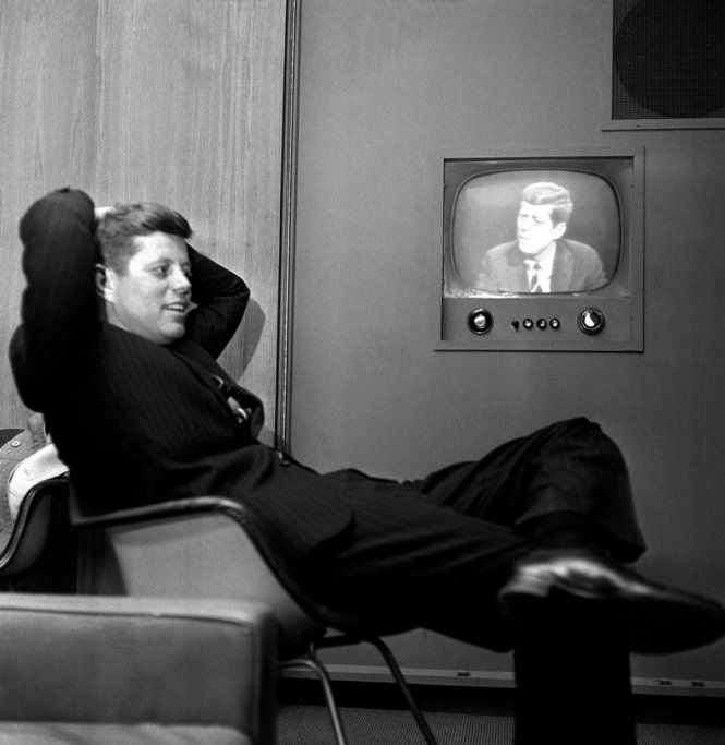 April 3, 1960: Sen. John F. Kennedy, Democratic presidential nominee, sits next to a playback of his televised appearance in Milwaukee, Wisconsin, for the Wisconsin presidential primary two days later. (AP Photo)