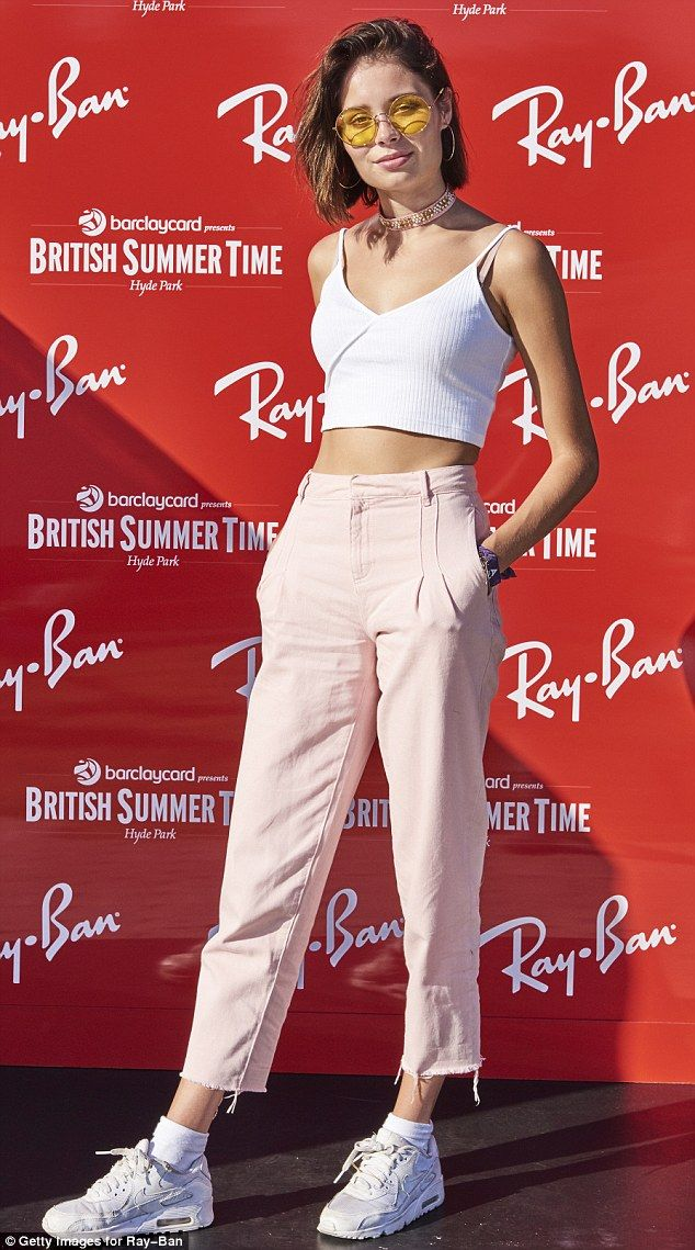 Trendy:Scottish singer-songwriter Nina Nesbitt, 22, looked edgy in a cropped vest top wit...