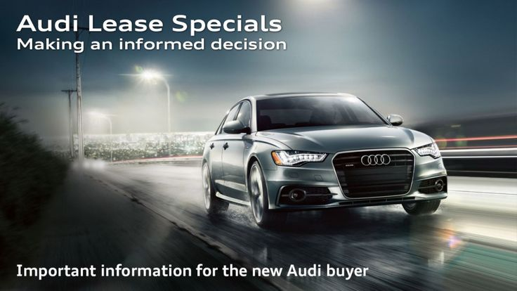 """Audi vehicle on a wet road with city lights in the background. Photo used to illustrate the article """"Audi Lease Specials - making an informed decision""""."""