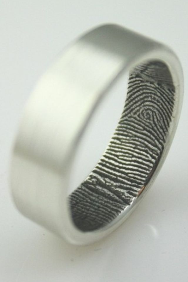 Super cool idea - finger print in the wedding band. I wonder if this is the designer's print or their love's...