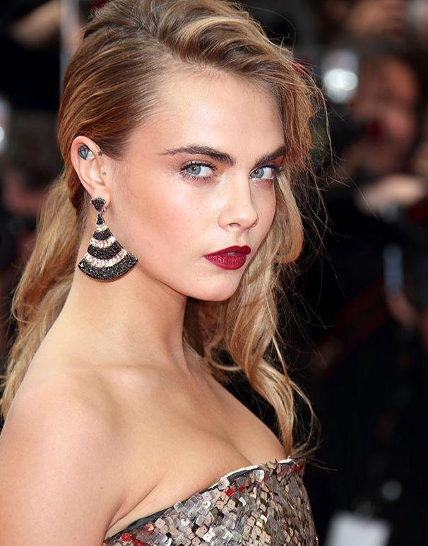 Cara Delevingne in statement black and white diamonds fan-shape #earrings  #Cannes2014 #trendy #jewelry