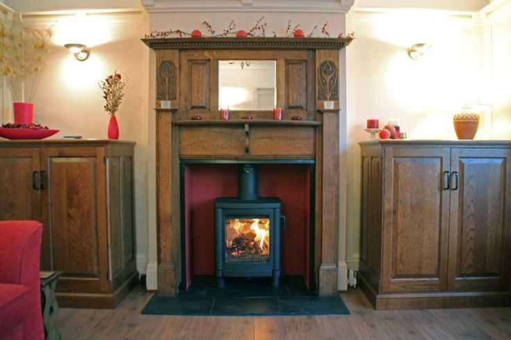 Antique 1920's oak mantel with heat proof skamolex boarded chamber, slate tiled hearth and Contura 51L wood stove. Fitted in Stratford London E20 2011