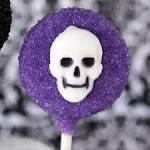 purple halloween sugar cookie on a stick