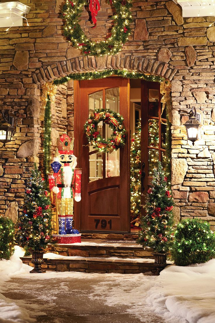 The wreaths and garlands are a lovely backdrop for our cheery nutcracker figure. We have everything you need to create this warm and whimsical look for your front door… or any other holiday style you can imagine. Chick through to explore the possibilities!