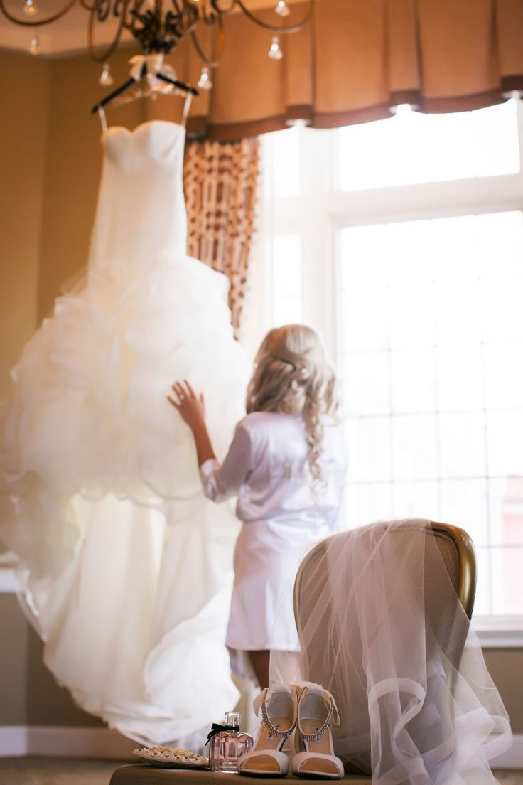 Must-have wedding photo idea: the bride with her dress and accessories (Limelight Photography)