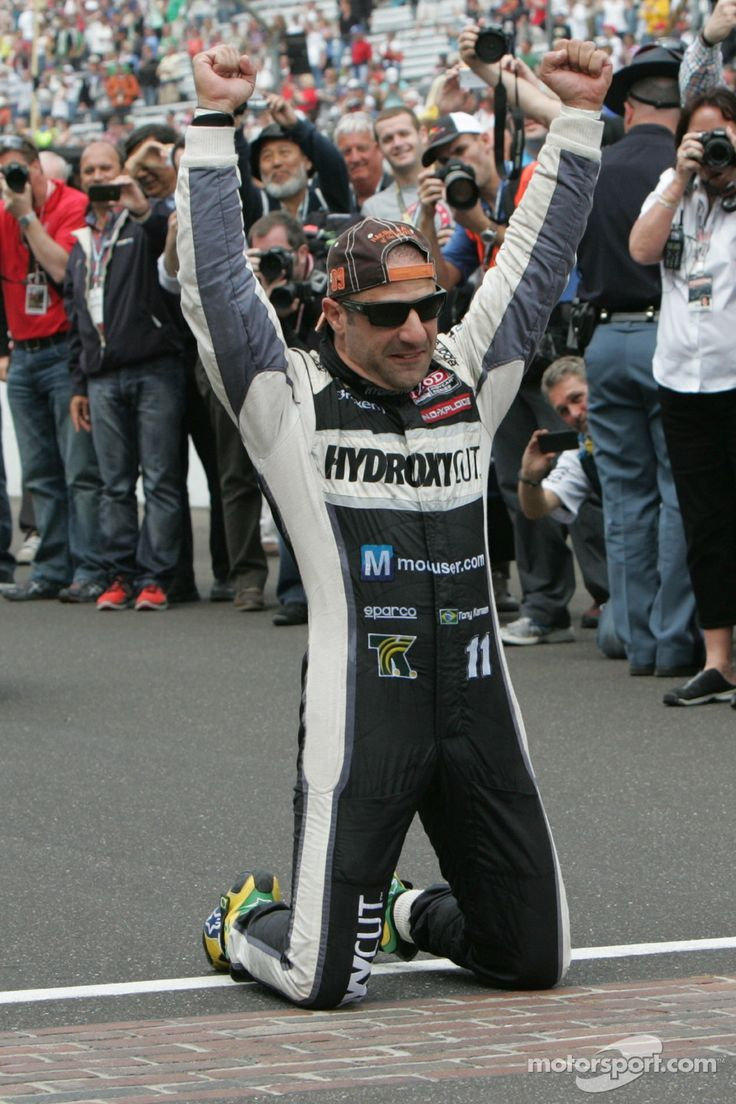 Tony Kanaan on bended knees to kiss the bricks after winning the 2013 Indy 500