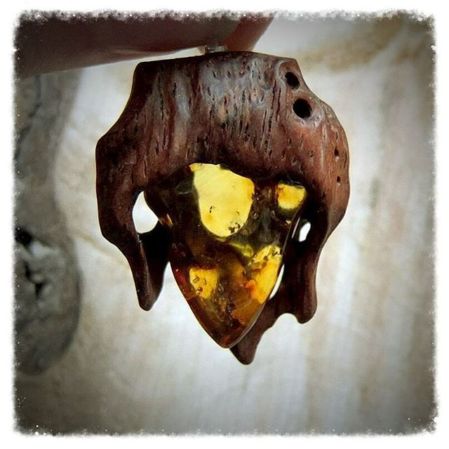 Wooden pendant with natural amber. Hand carving.    #uniquepieces  #rusticwood  #witchjewelry #bohojewellery  #witchyvibes   #amberjewelry  #artjewelry  #bohemianjewelry #woodgrain   #lovedetails   #bohemianjewellery  #woodenjewelry #woodenpendant  #woodcarving  #naturalwood  #naturaljewelry  #instafashions  #hippiestyle  #darkfantasy  #gipsyjewels  #hippiesoul  #finewood  #ambernecklace