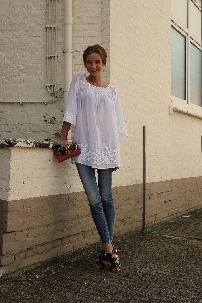 White tunic & jeans.