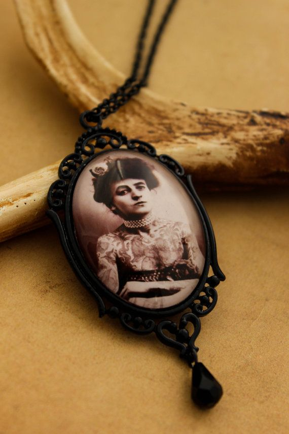 Victorian Tattooed Lady Necklace    This necklace was created using a Victorian tattooed Lady. Set in an ornate black coated metal frame frame