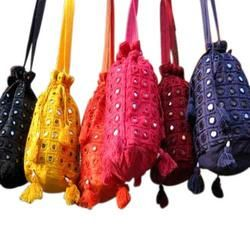 Indian Bag  [http://www.go-ethnic.com/corporate-video.html]  Welcome to Bani – ThaniManufacturer & Exporter of Hand Bags, Traditional Footwears, Ethnic Jewellery & DecorativeItemThe company was incepted in 1995 at Raipur. We cater to Africa, East Asia, Middle East & othercountries. Attractive blend of design, Effective packaging facility, large product lines and stringent qualityinspection are some of the key factors behind our success.