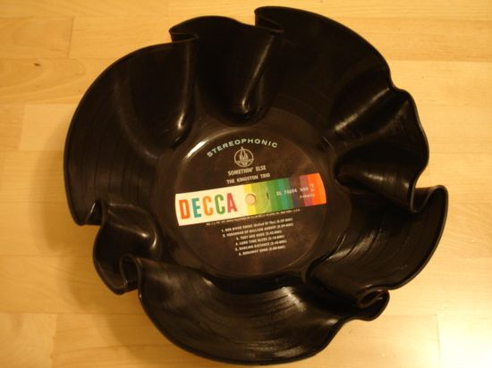 apparently I have developed an obsession with melting things... but I like inexpensive decor for the youth room... check out this record bowl