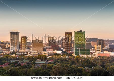 Pretoria (Tshwane), South Africa - April 17th, 2016. Sunrise view of city center skyline. mountains, drakensberg, amphitheatre, south africa, african, travel, natal, landscape, landmark, nature, green, grass, blue, sky, beautiful, clouds, peaks, rocks, park, valley, water, hiking, outdoors, tourism