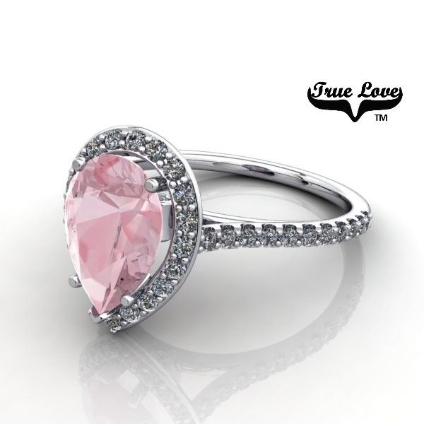 One Pear Shape Light Pink Morganite , Two Accented Moissanites and Thirty six halo and side Diamonds diamonds set into 14 kt.White Gold.