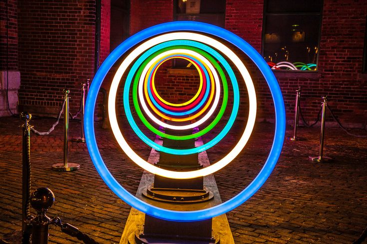 """The Toronto Light Festival is a free event designed to inspire local citizens to get out of their homes during the cold winter months.  """"Featuring 21 diverse light installations built by local and international artists and thousands of glowing bulbs, the festival covers a total of 13 acres in the city's Distillery District. Installations range from a series of lit figures appearing to jump from the roof of one of the historic buildings to two red, geometric cats prowling an included alle..."""
