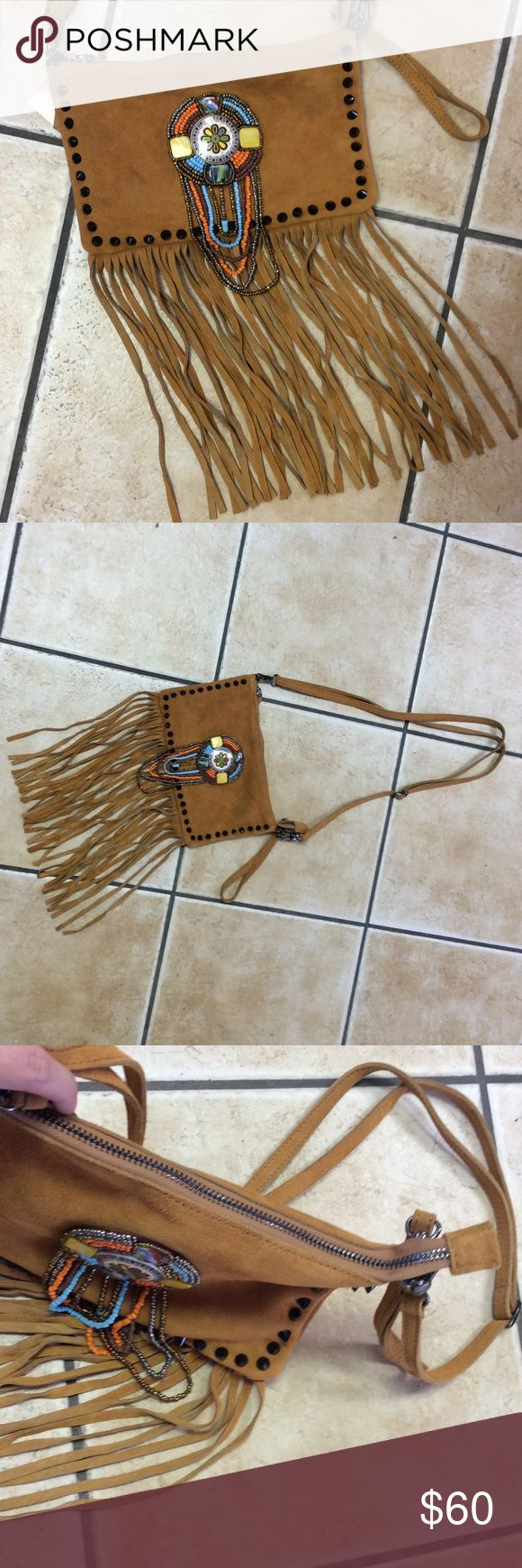 Leather Beaded Purse Beautiful leather, studs, beaded bag. Perfect size. Detachable long adjustable strap. Also has a wristlet strap. New with tags. Perfect for festivals. Free people like, but not free people brand! No  Bags Shoulder Bags