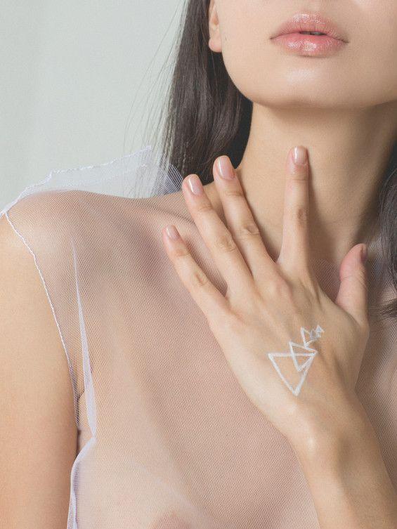 Beauty shot. Geometrical white shapes and delicate shirt. By Evgenya Kayumova
