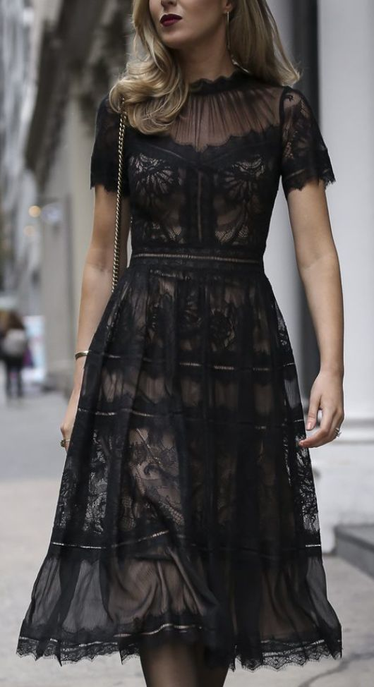black lace dress- modest neckline and hemline, but with peek-a-boo appearance