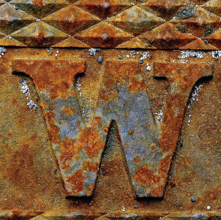 Rusty W. I like the different colours in this photo. I also like how the 'W' is embossed as this gives it some depth, along with the pattern at the top.