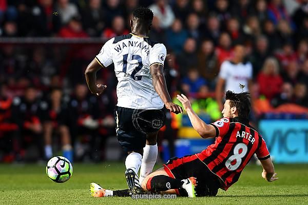 BOURNEMOUTH, ENGLAND - OCTOBER 22: Victor Wanyama of Tottenham Hotspur (L) is tackled by Harry Arter of AFC Bournemouth (R) during the Premier League match between AFC Bournemouth and Tottenham Hotspur at Vitality Stadium on October 22, 2016 in Bournemouth