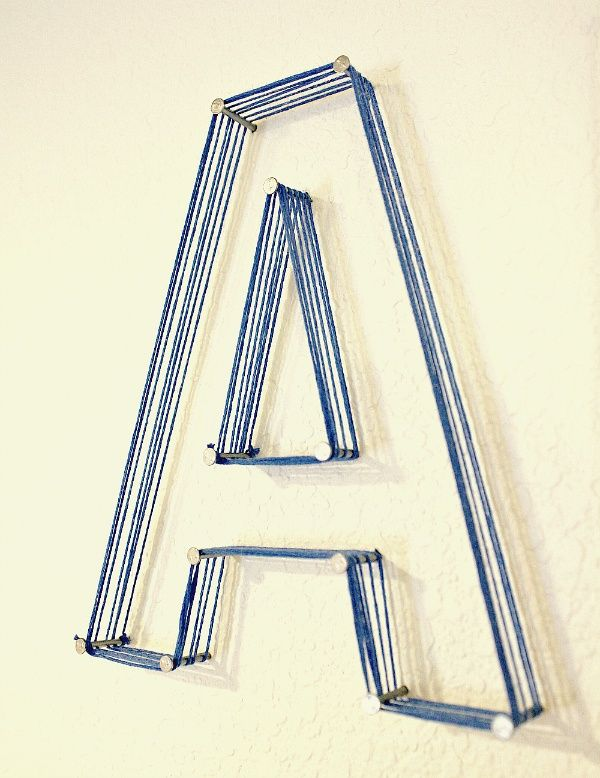 Nail  string lettering... so much you could do with this, and would be easy to just mount the nails on a piece of painted plywood rather than the actual wall...