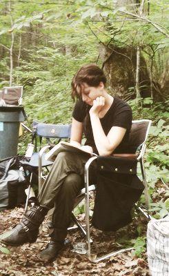 Jennifer Lawrence reading on The Hunger Games set (2011)