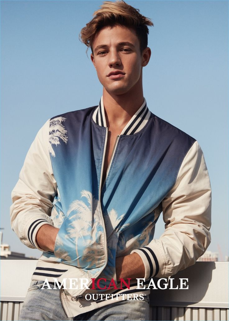 Cameron Dallas rocks a trendy bomber jacket with a palm tree print for American Eagle Outfitters' spring 2017 campaign.