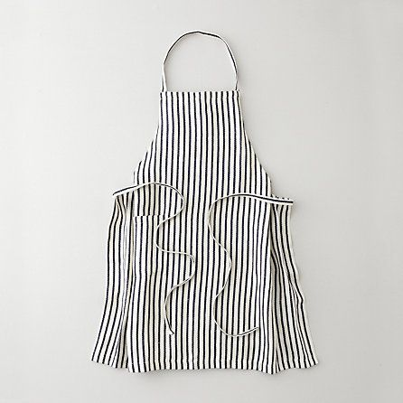 A girl needs to protect her pretty dresses from splatters. Linen Apron by Fog Linen Work.