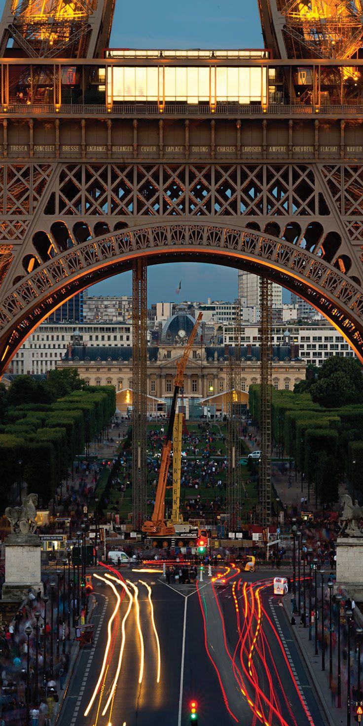 Trails of traffic under the Eiffel Tower in France - by Lauren Bath