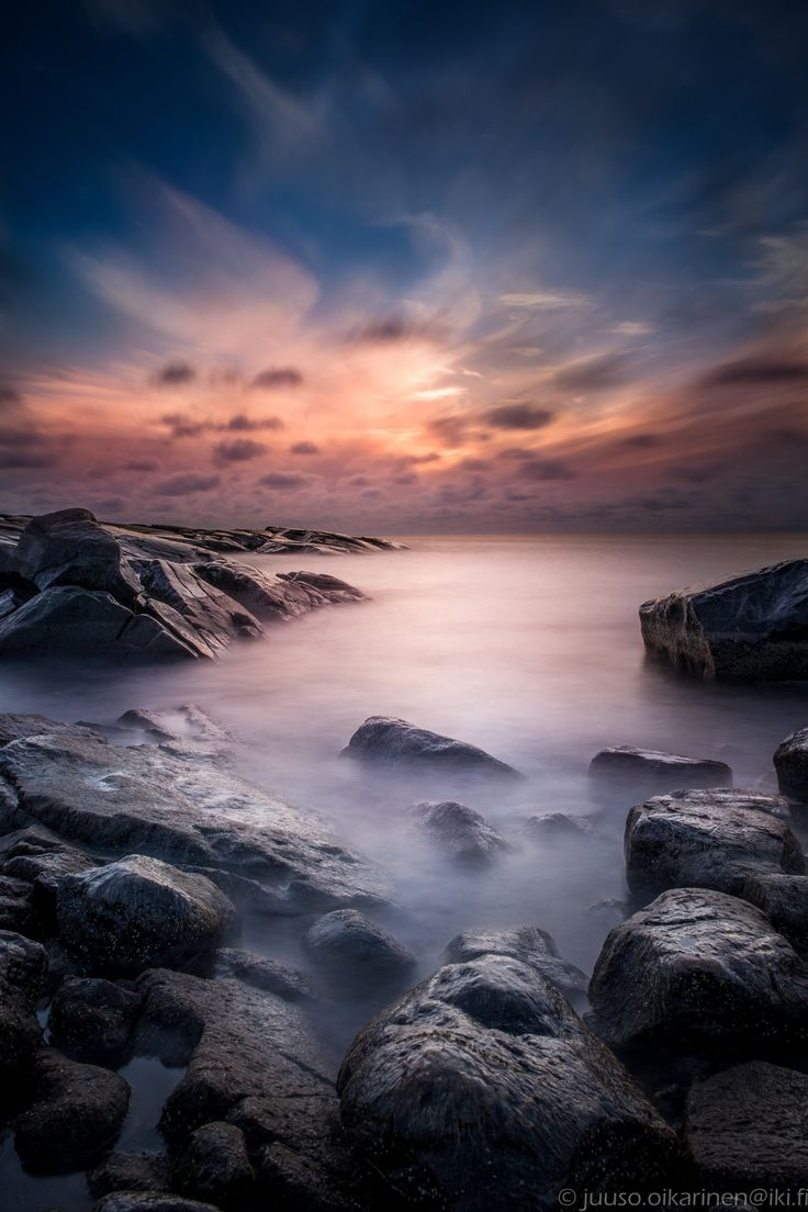Home of the sea monster - This is a very long exposure of a restless welling sea at Kallo in the city of Pori, Finland. The shiny white specks on the rocks are ice and frost.