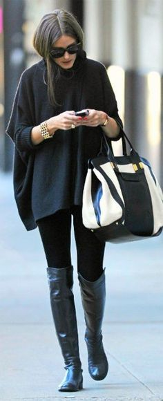 Black poncho, black leggings, boots, and an oversized bag. So chic.