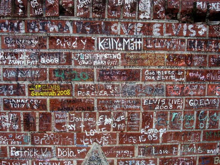 the wall around Graceland with name's of Elvis fans !