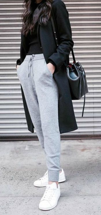 Linh Niller Huynh + 'comfy chic' style + pair of marl grey joggers + black tee + matching overcoat + sneakers + sporty element     Joggers: Granacom.