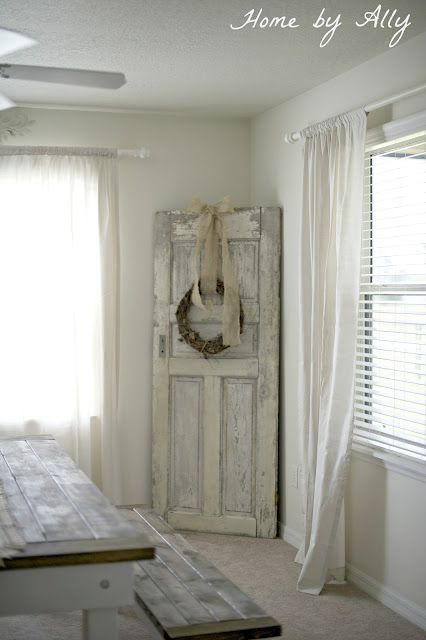 Old door with wreath. Dress up for any holiday or season. LOVE. Over at Home by Ally